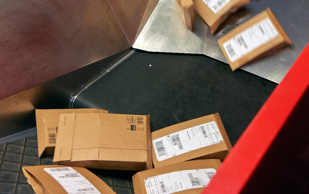 A lot of small parcels on a conveyor.